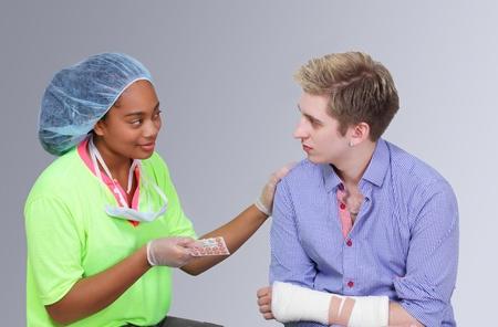 reassure: Medical worker assisting patient explains medication