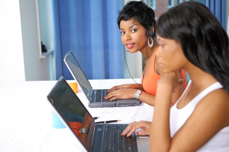 Pretty girls working on laptops photo