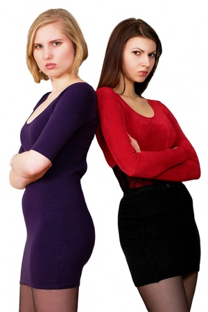 frowning: Angry young women Stock Photo