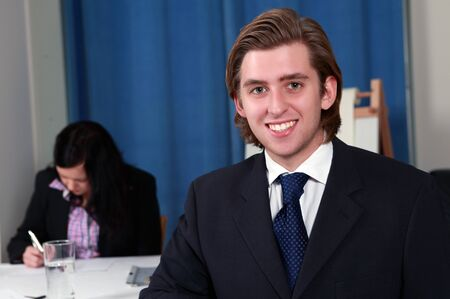 Smiling male executive in business meeting photo