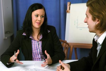 2 persons: Female executive presenting a concept or idea Stock Photo