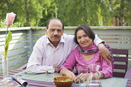 Retire indian couple in relaxed lifestyle Stock Photo