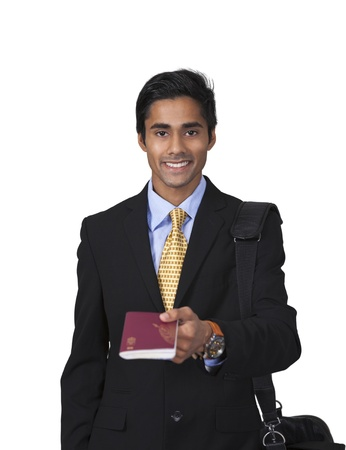 Smiling male traveler shows passport Stock Photo