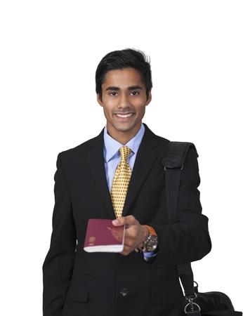 Smiling male traveler shows passport photo