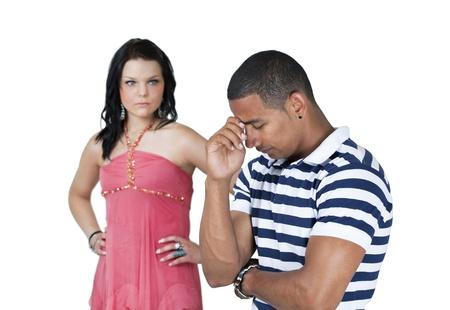 pareja enojada: Pareja infeliz con el foco en el hombre