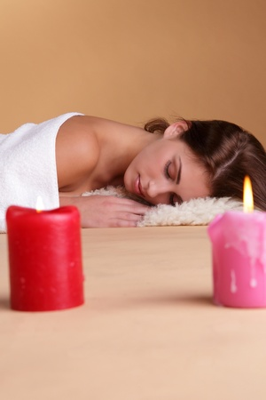 Woman in spa with candlelights photo