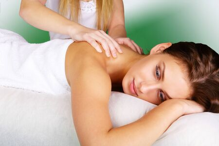 Young lady pampering herself with a massage Stock Photo - 11597309