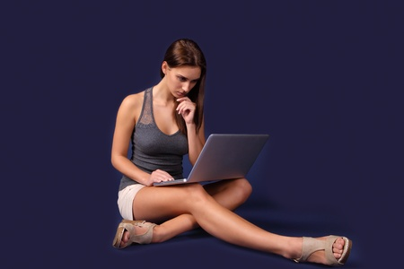 Modern young woman busy on laptop Stock Photo - 11597312