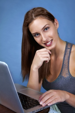 Young woman in trade fair on laptop Stock Photo - 11594549