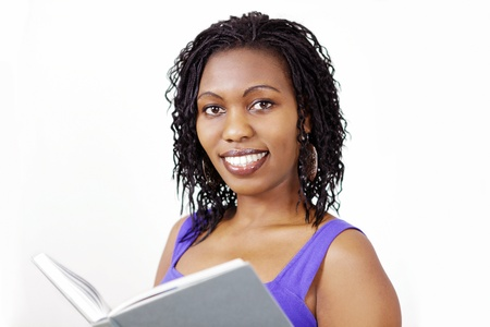 hardback: Lovely smiling woman with book Stock Photo