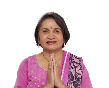 salwar: Mature indian woman doing namaste greeting with joined hands Stock Photo