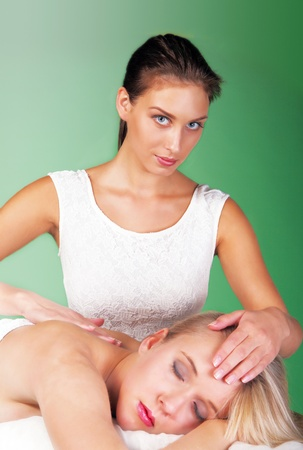 Reiki healer with patient and chakra balancing photo
