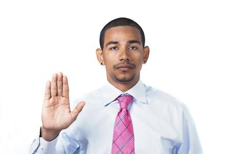 official: Hispanic man taking oath or pledge hand raised