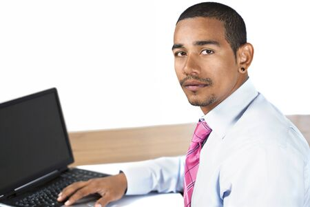 turning table: Hispanic office man looking up serious expression Stock Photo