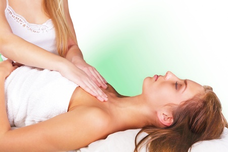 Lovely woman in spiritual healing reiki session photo