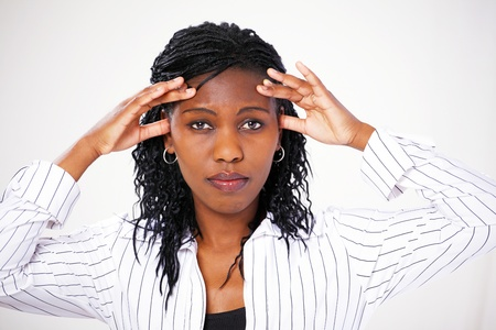 Smart african woman with stressed expression photo
