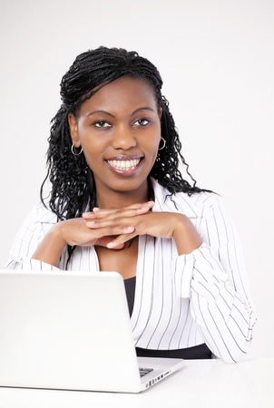 fashon: Smiling female executive with laptop looking at you