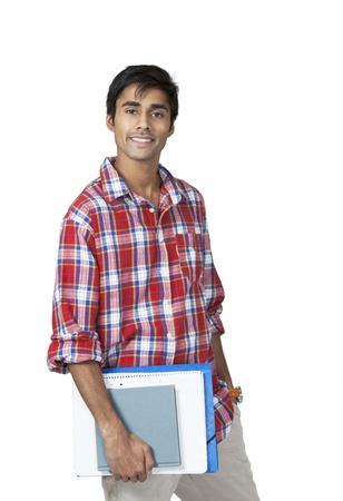 handsome student: Lindo chico de la universidad con la expresi�n libre de preocupaciones