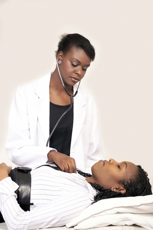 Serious African lady doctor examining patient photo