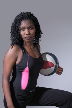Tough black sportswoman holding basketball photo