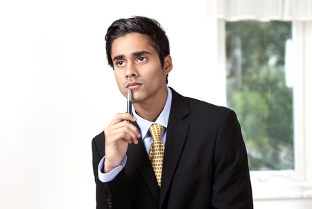 Young businessman thinking serious expression Stock Photo