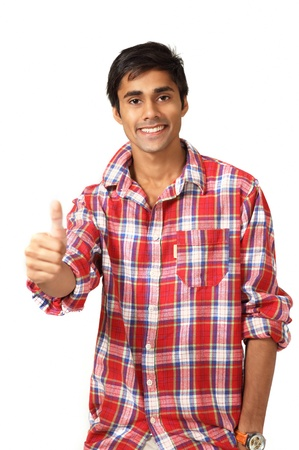 Thumbs up gesture by cute smiling guy photo