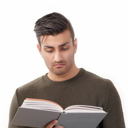 Young man reading book photo
