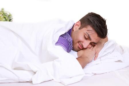 buonanotte: Felice l'uomo dorme nel letto