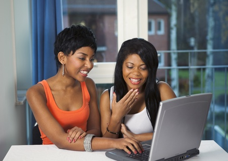 Girls socializing or chatting on internet having fun Stock Photo
