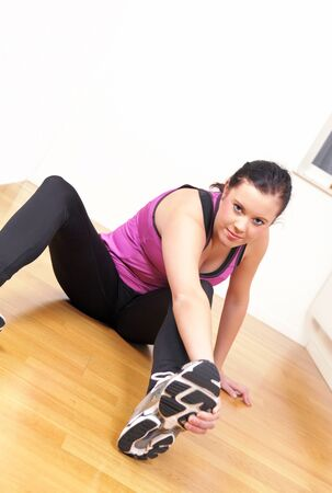 Gym girl stretching exercise photo