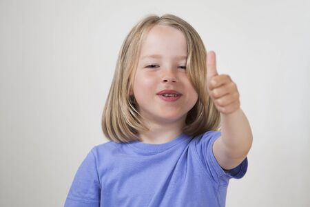 blond boy: Thumbs up -cute child Stock Photo