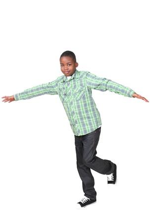 skipping: Cute african boy balancing on one leg