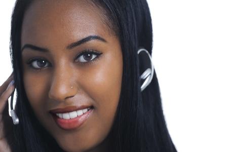nosering: Beautiful ethnic telephone operator with headset