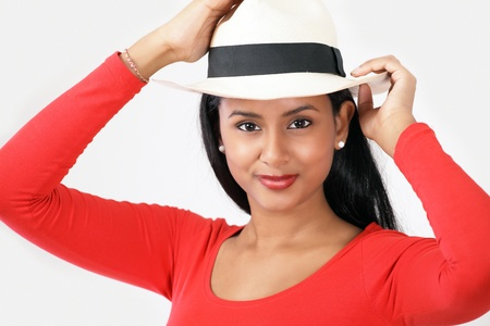 Cute smiling young woman in summer hat photo