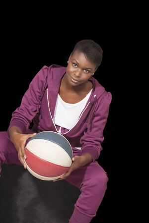 Woman basketball player casual pose black background photo