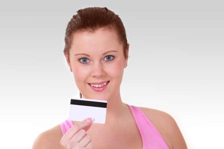 Smiling woman holding card with magnetic strip Stock Photo - 12275560