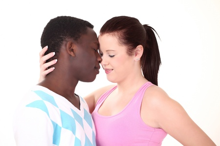casuals: Beautiful mixed couple in loving embrace Stock Photo