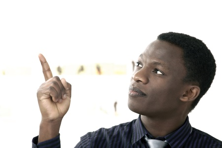 Serious african man pointing to copy space
