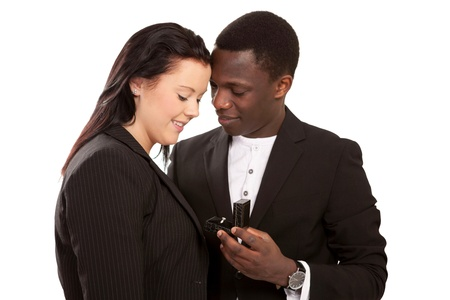 Focus on diamond ring with man proposing to girl Stock Photo - 12376905