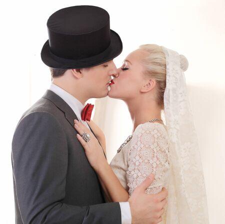 Beautiful wedding couple kissing photo