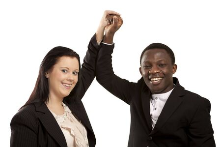 Happy business partners holding hands cheering Stock Photo - 12622217