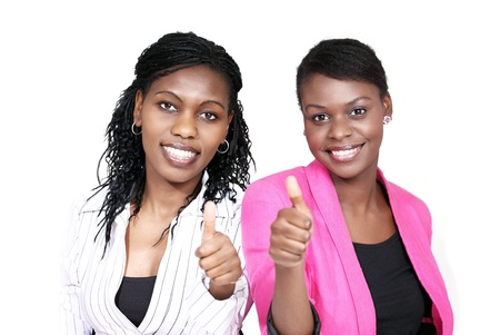 Thumbs up - two smiling women Stock Photo