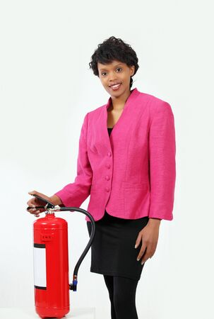 fire fighting equipment: Professional woman presenting fire extinguisher