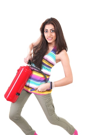 Fire drill girl practicing with fire extinguisher Stock Photo
