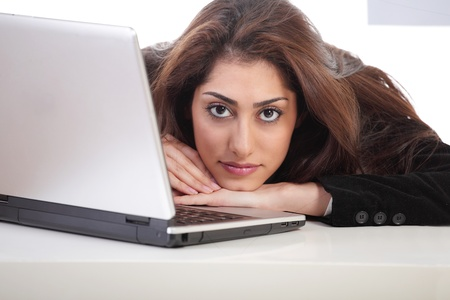 beautiful sad: Pretty girl resting head on laptop