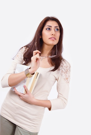 Thoughtful college girl holding books Stock Photo - 12622515