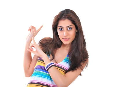 sincere girl: Sweet girl pointing back to copy space Stock Photo