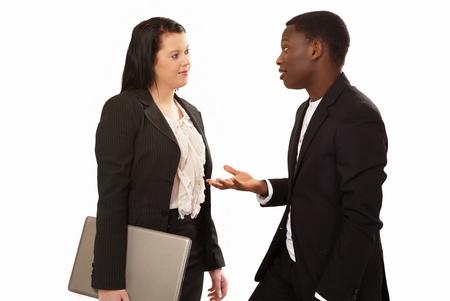 dos personas conversando: La gente de negocios en la carrera de la conversaci�n mixta Foto de archivo