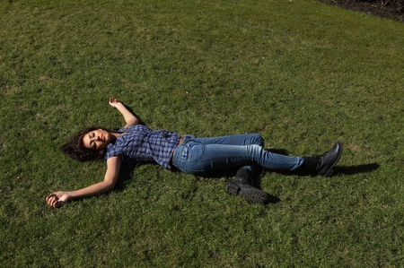 Female dead body lying in a park Stock Photo - 12908423