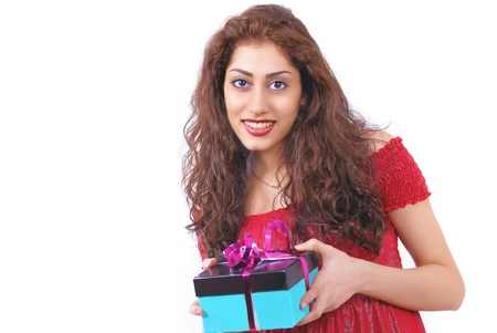 courteous: Cute smiling female holding a gift-box Stock Photo